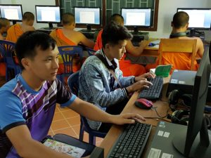 Lao Students enjoying computer class